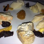 Chef's assortment of five Italian cheeses served with dried fruit and sweet mustard