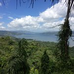 View of Arenal lake partway down zip lines