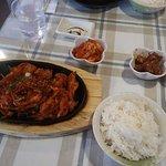 Spicy BBQ chicken with veggies.