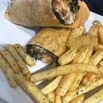 Grilled Chicken and haloumi wrap with a side of fries YUM