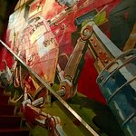 Cool colorful mural on the wall going upstairs.