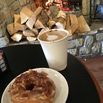 Enjoying a Maple bacon donut and latte near the fire