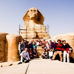 Funny Group Between The Legs Of Sphinx