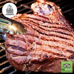 A thirty eight day dry aged T Bone grilled with our exclusive basting sauce