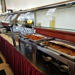 Look at the long buffet area, so many tasty dishes!