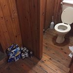 Discarded beer cans and urine on the floor.