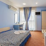 Double room carpeted decorated in bright blue colours