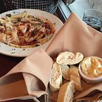 Penne pasta with sun-dried tomatoes and grilled salmon.  Delicious!  Love the Bistro's bread and