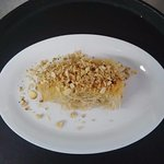 Kataife - dessert of shredded filo pastry wrapped with walnuts, pistachios and honey.