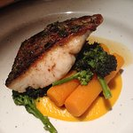 Hake on a bed of butternut purée, broccoli and carrots