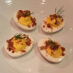 Deviled egg appetizer with bacon topping
