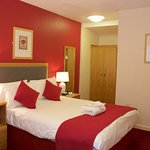 Recently and completely re-furbished standard double room. New bed, furniture, carpet & lighting