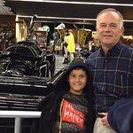 3 batmobiles, batcycle, batplane with grandson