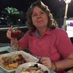 Enjoying the Sirloin steak special and a glass of sangria