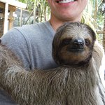 Son holding a sloth