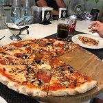 Pepperoni and mushroom thin crust pizza at La Famiglia