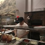 Hand-made pizzas in a brick oven