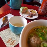 Pho and spring roll with green tea