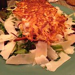 Sweet Potato Encrusted Salmon on a bed of greens with Fresh Parmesan Cheese!
