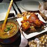 Laziza Nihari & Afghani mixed plate with a tandoori roti by the side