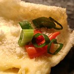 Keropok (shrimp cracker) topped with durian and Parmesan