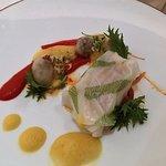 Norwegian cod with stuffed calamari and pepper coulis