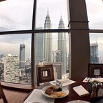 Enjoy 360 degrees view of the KL skyline during breakfast