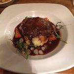 Braised daube of beef served with creamed potatoes, buttered chantilly carrots and baby  onions,