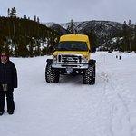 Snow coach with ballon tires.