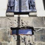 Bullet scarred memorial