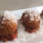 Arancini stuffed with fontina, gorgonzola, over romesco