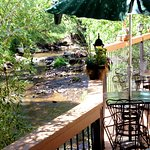 Enjoy a glass of wine and a fantastic meal on our deck overhanging Bear Creek
