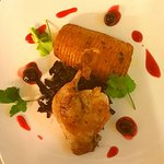 confit duck with hasselback potato, braised red cabbage and sour cherry sauce