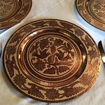 Beautiful table with etched copper charger plates