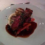 Reindeer with celeriac mash, caramelised carrots, potato, and a red wine sauce