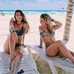 Elyssa and I on the beach beneath the palapas
