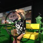 little one clambering over large tractors