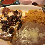 This is grilled chicken breast with chorizo and cheese, refried beans and rice.