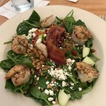 Spinach salad with added seared shrimp and BACON