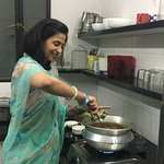 Deepti cooking for the guests