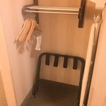 Short bars for hanging clothes in narrow space