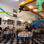 Interior of Toula's. Bicycles on the wall and bicycles passing by outside.