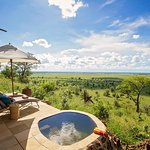 view of pool and chobe floodplain from bedroom