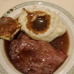prime rib with mashed potato and gravy