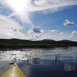 Kayaking on Wilson Lake in Wilton, Maine - photo by Susan Atwood