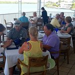 Outside covered dining with waterfront views at Bayfrond Bistro.