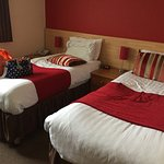 We sat on the beds and they were very comfortable. The room overall was very clean and light.