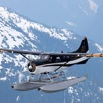 N7336 flying through snowcapped mountains in the Misty Fjords National Monument.
