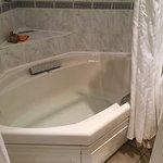 Massive corner bath with on wall shower