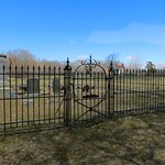 Iron fence surrounds family cemetery.